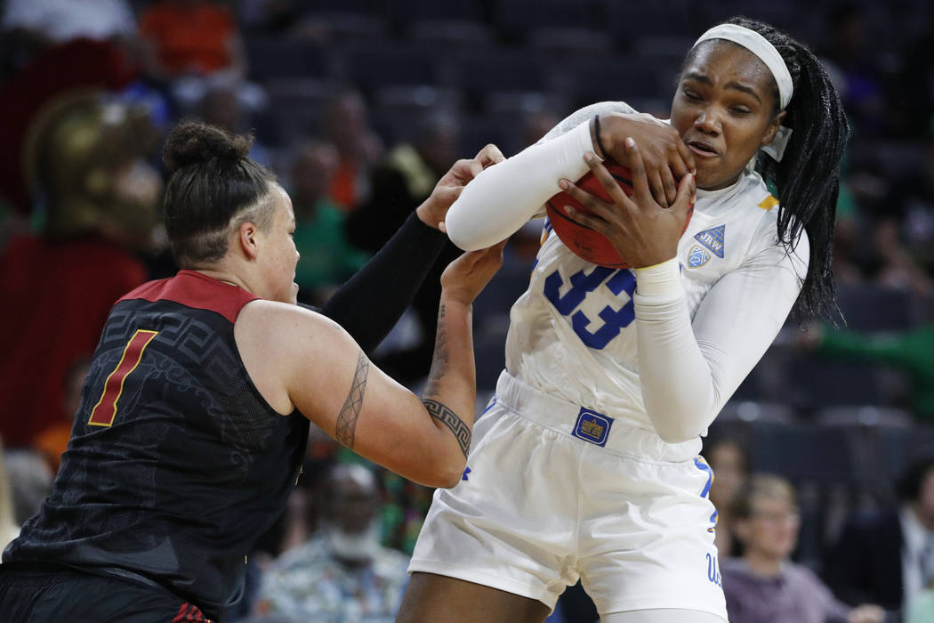 UCLA's Lauryn Miller (33) grabs a rebound over Southern California's Kayla Overbeck (1) during ...