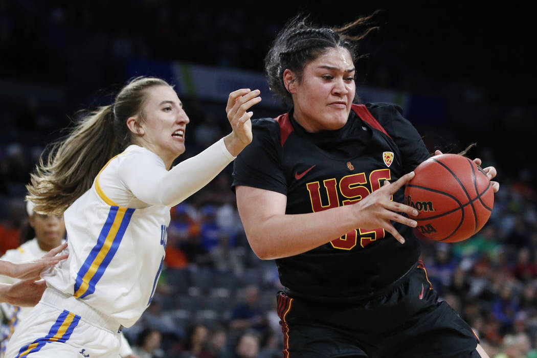 Southern California's Alissa Pili (35) drives around UCLA's Chantel Horvat (0) during the first ...