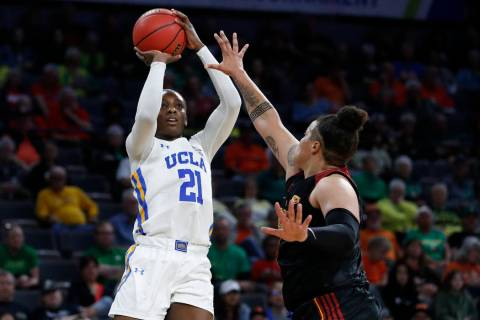 UCLA's Michaela Onyenwere (21) shoots over Southern California's Kayla Overbeck (1) during the ...