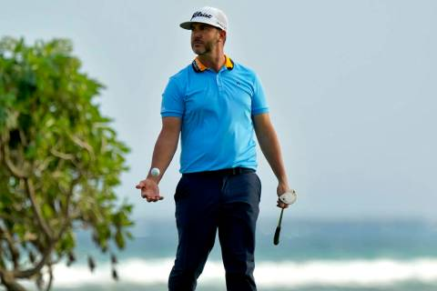Scott Piercy tosses his ball after missing his birdie putt on the 16th green during the first r ...