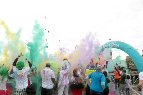 Runners gather at the end of the Color Run for one of many color throws. (Anton)