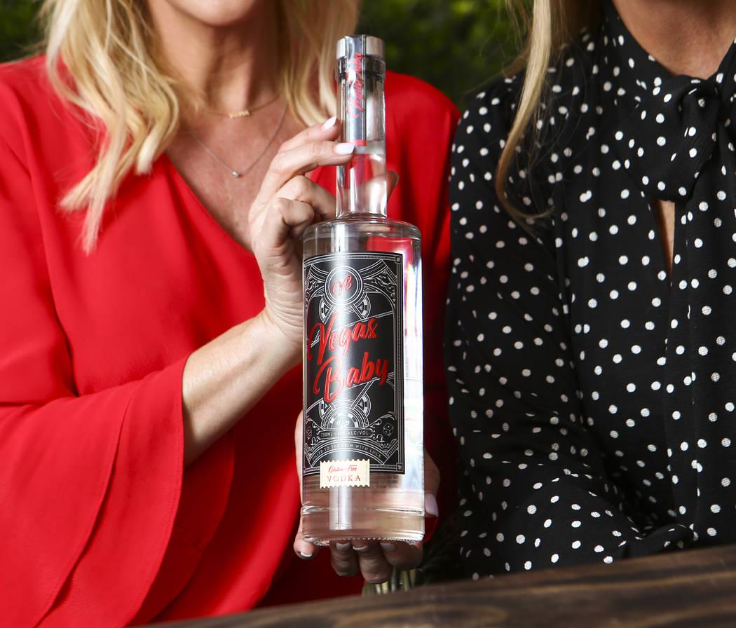 Vegas Baby Vodka co-founder Jennifer Higgins holds a botle of the brand's vodka in Las Vegas on ...