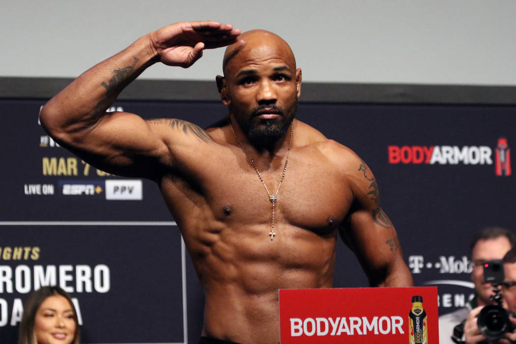 UFC middleweight Yoel Romero poses on the scale during the UFC 248 ceremonial weigh-ins at the ...