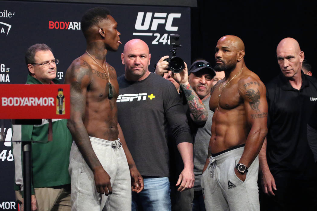 UFC middleweight champion Israel Adesanya, left, faces off against title challenger, Yoel Romer ...