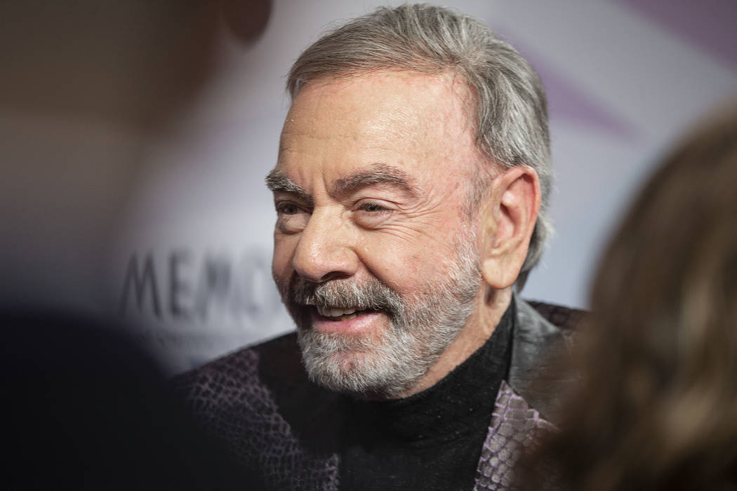 Neil Diamond talks with the media on the red carpet during the 24th Annual Power of Love Gala o ...