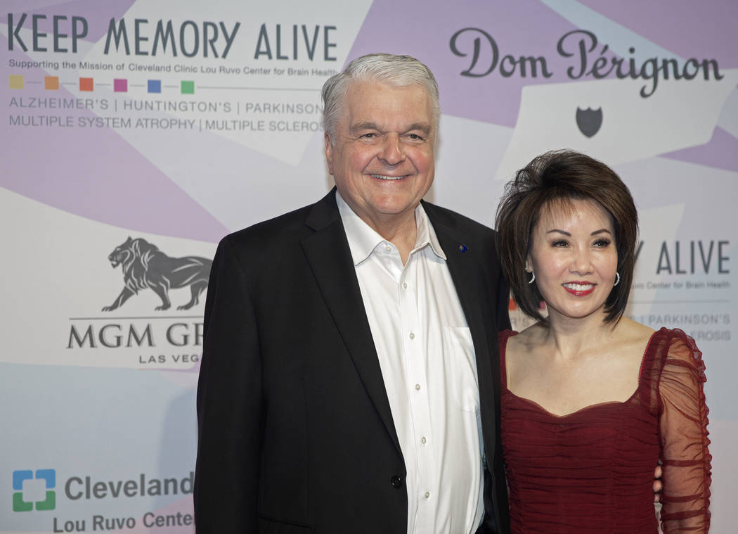 Gov. Steve Sisolak, left, and wife Kathy walk the red carpet during the 24th Annual Power of Lo ...