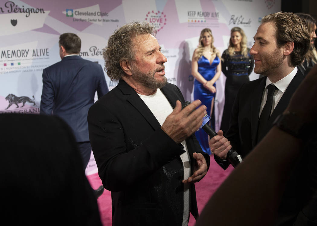 Sammy Hagar, middle, talks with the media on the red carpet during the 24th Annual Power o ...