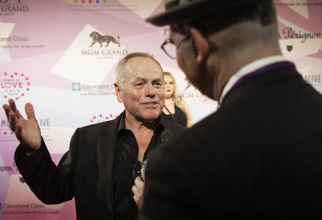 Wolfgang Puck talks with the media on the red carpet during the 24th Annual Power of Love Gala ...