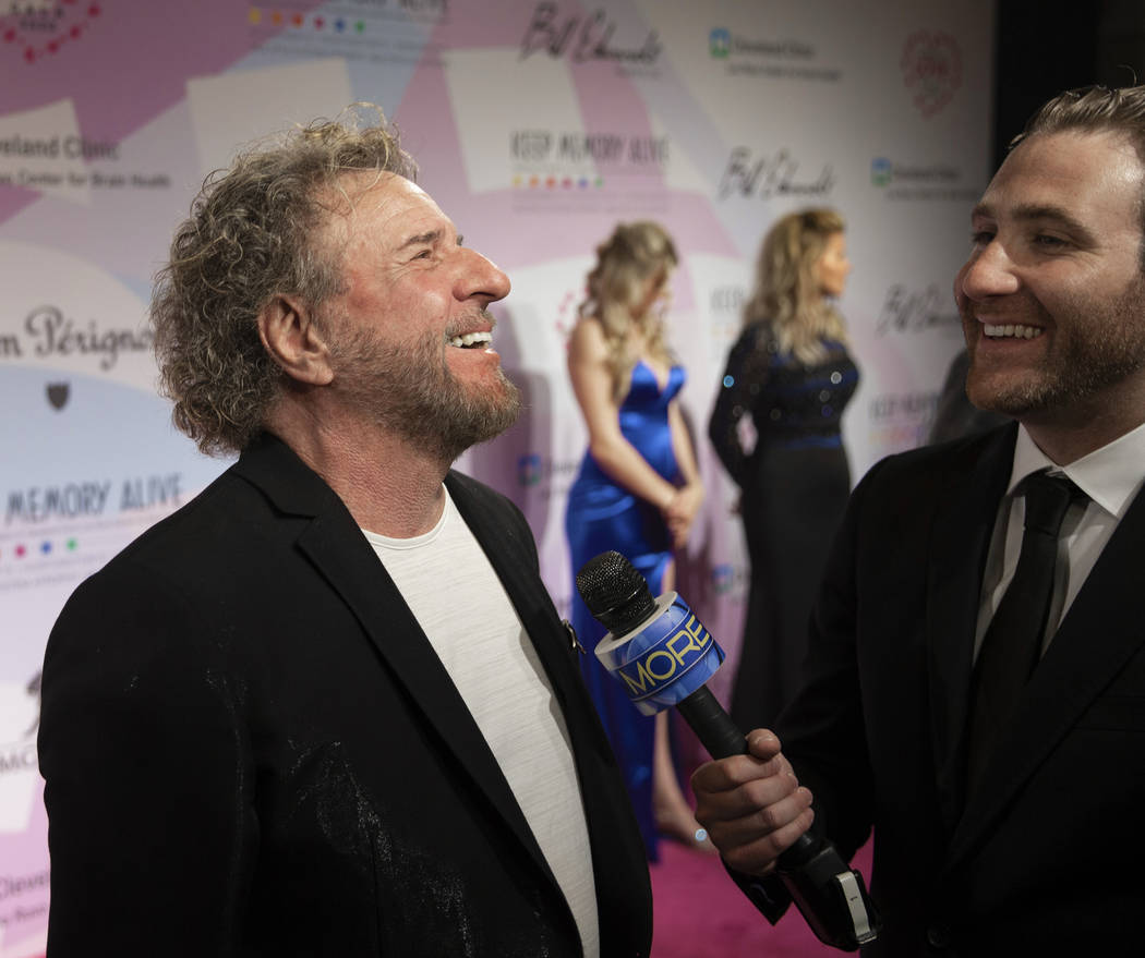 Sammy Hagar, left, talks with the media on the red carpet during the 24th Annual Power of ...