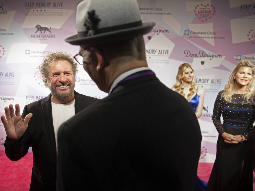 Sammy Hagar, left, shares a laugh with the media on the red carpet during the 24th Annual Power ...