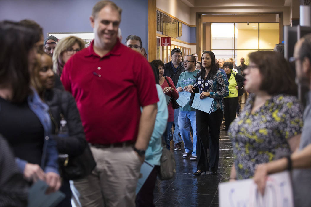 Residents wait in a long line for the second of three open house style meetings the city hosted ...