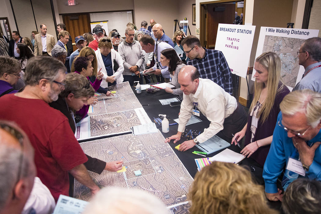 Locals ask city officials questions about traffic and congestion at a meeting the city hosted t ...