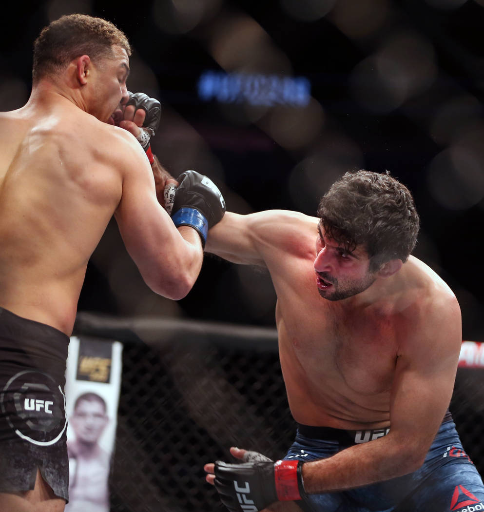 Lightweight Drakkar Klose, left, punched in the face by Beneil Dariush during the second round ...