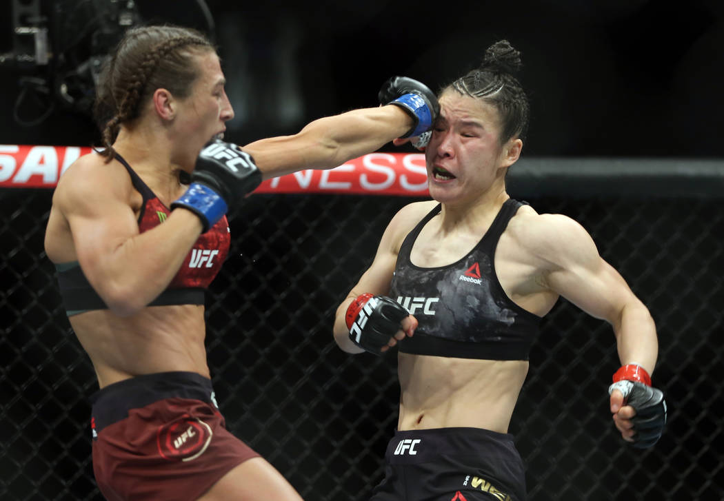 WomenÕs Strawweight Joanna Jedrzejczyk, left, connects on Weili Zhang during the first rou ...