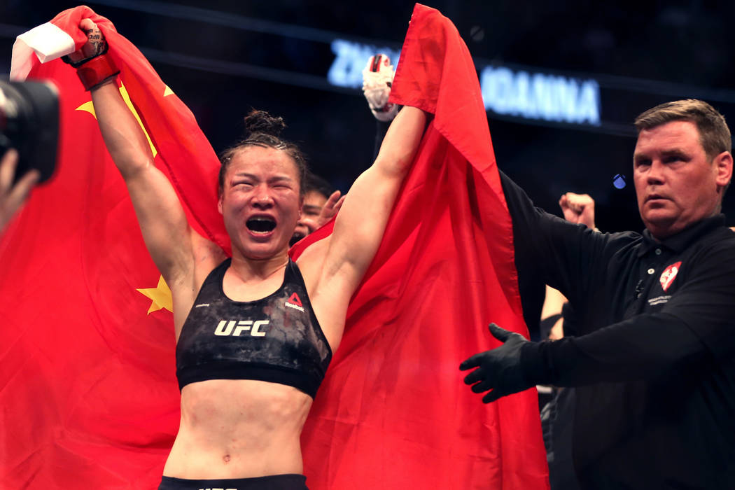 Women's Strawweight Weili Zhang celebrates her win on a decision over Joanna Jedrzejczyk during ...