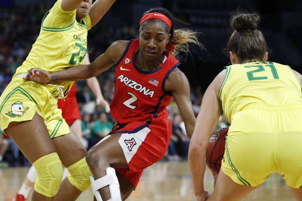 Oregon's Erin Boley (21) steals the ball from Arizona's Aarion McDonald (2) during the first ha ...