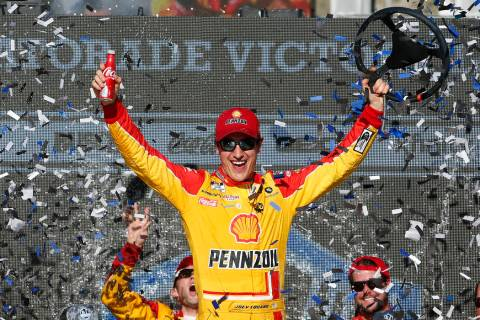 Driver Joey Logano celebrates in Victory Lane after winning a NASCAR Cup Series auto race at Ph ...