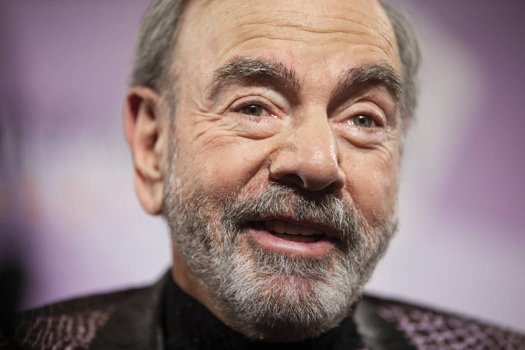 Neil Diamond speaks with the media on the red carpet during the 24th Annual Power of Love Gala ...