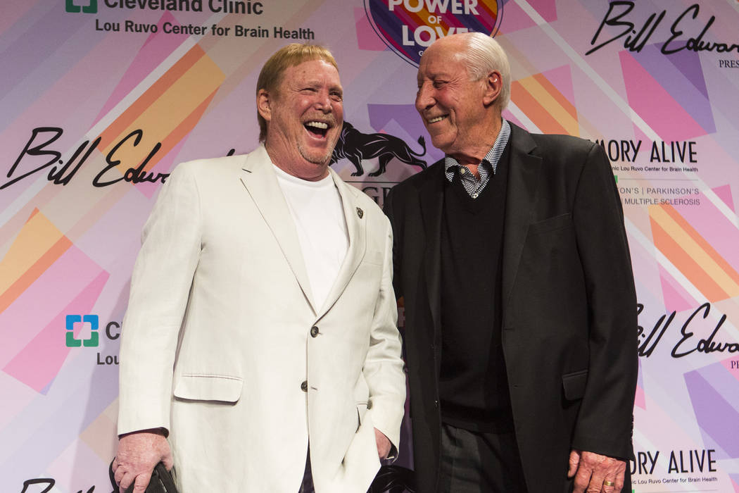 Oakland Raiders owner Mark Davis, left, poses with former Raiders player and coach Fred Biletni ...