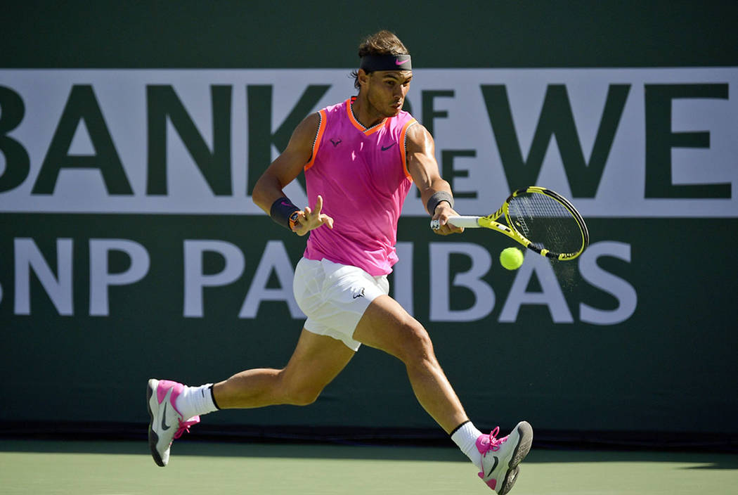 Rafael Nadal, of Spain, hits a forehand to Karen Khachanov, of Russia, at the BNP Paribas Open ...