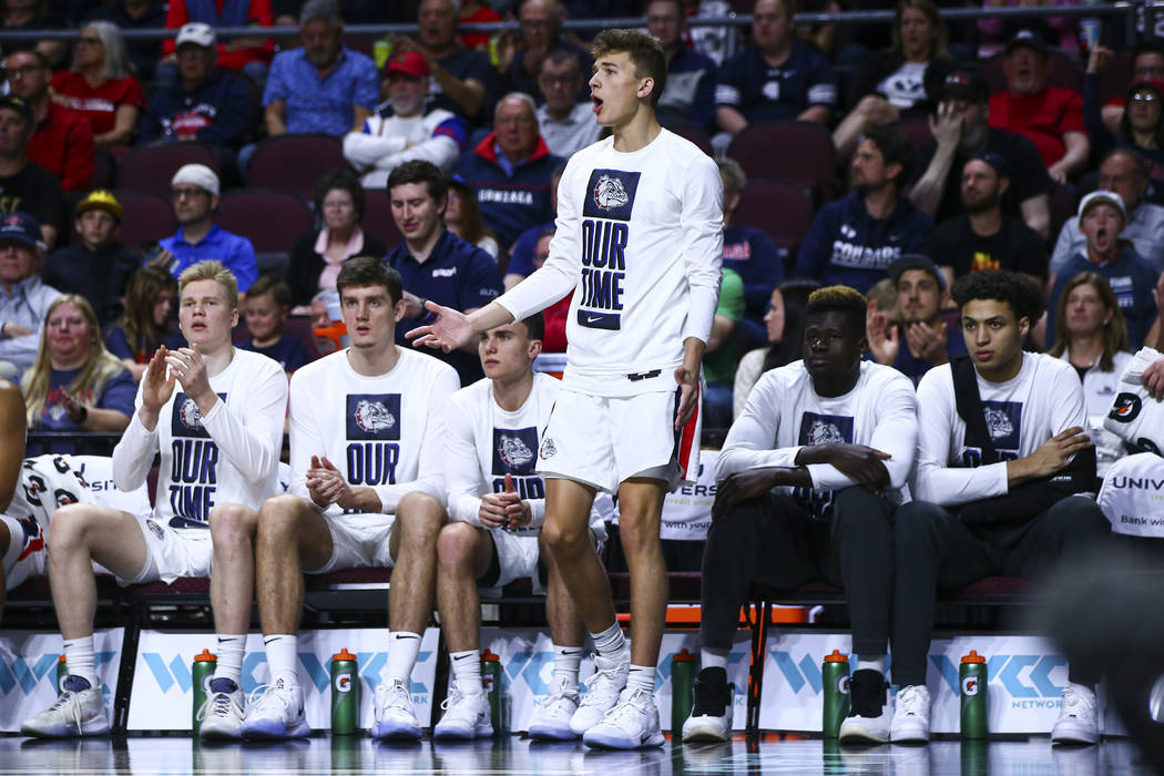 Gonzaga Bulldogs' Will Graves, center, reacts during the second half of a West Coast Conference ...