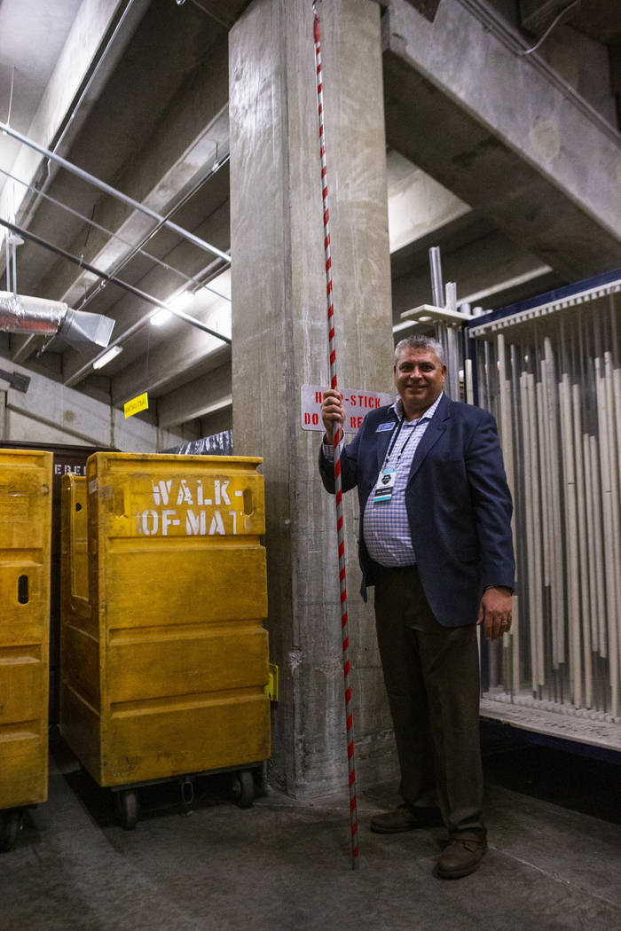Rex Berman, Director of Arena Operations at Orleans Arena, holds the hoop stick during West Coa ...