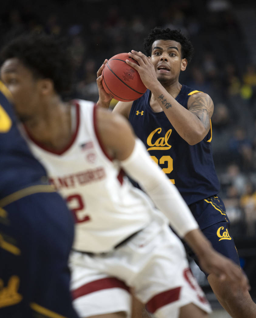 University of California, Berkely's forward Andre Kelly (22) looks to pass the ball during the ...