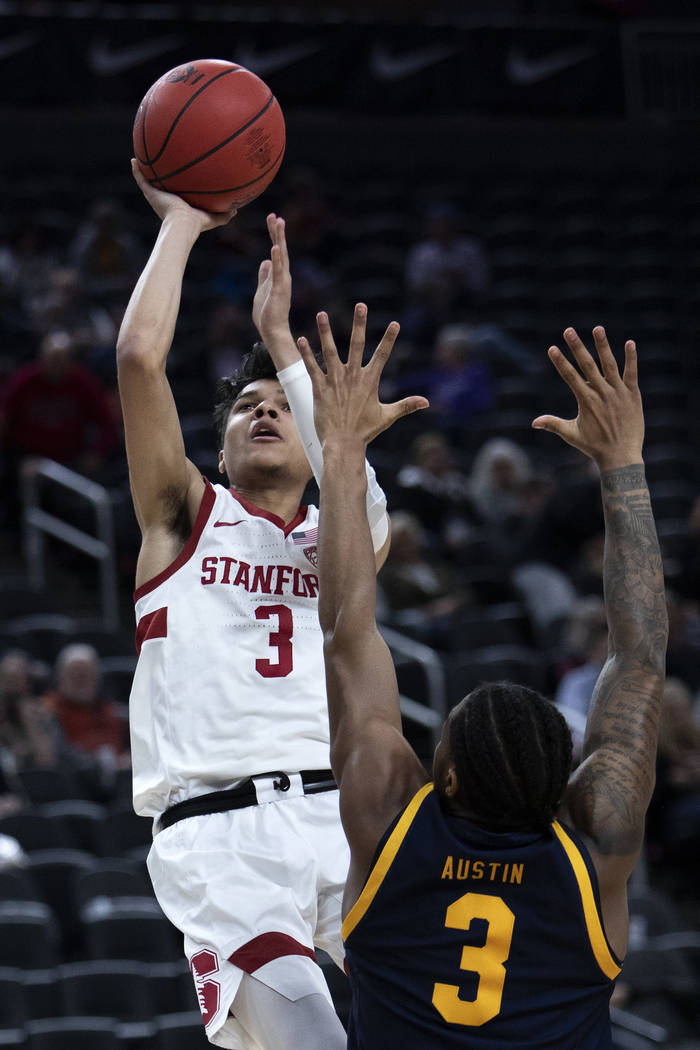 Stanford's guard Tyrell Terry (3) shoots a point as California's guard Paris Austin (3) jumps t ...