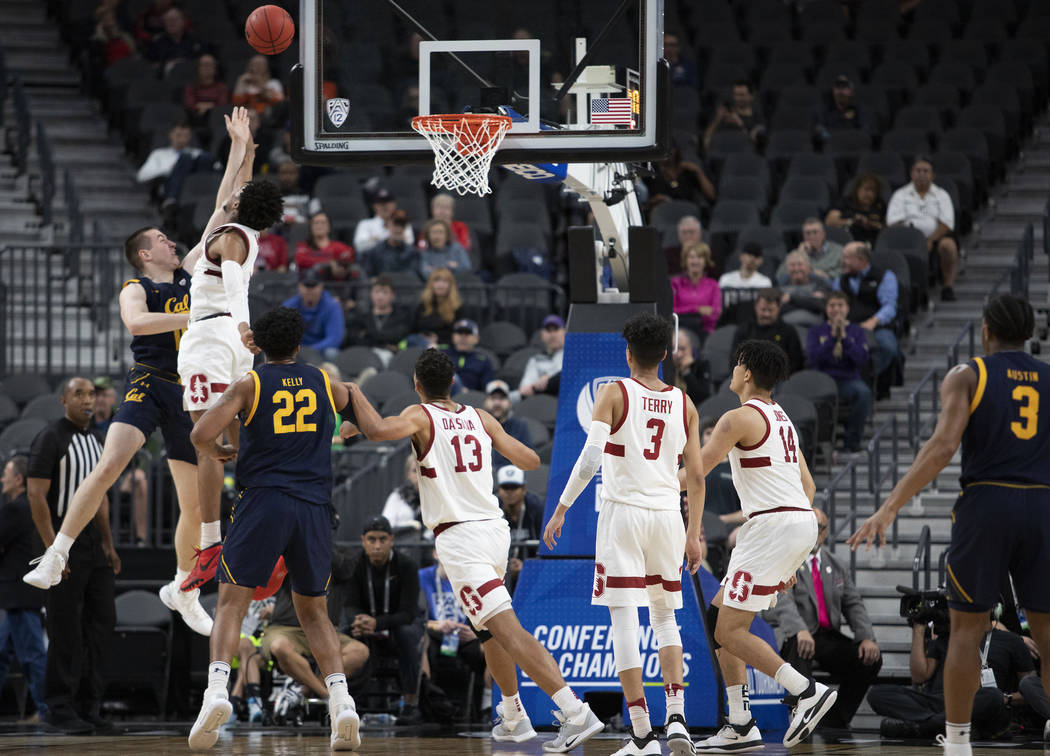 Stanford's guard Bryce Wills (2) blocks a point by California's forward Grant Anticevich (15) d ...