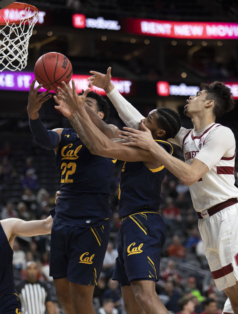 Stanford's forward Jaiden Delaire (11) attempts a point as California's forward Andre Kelly (22 ...