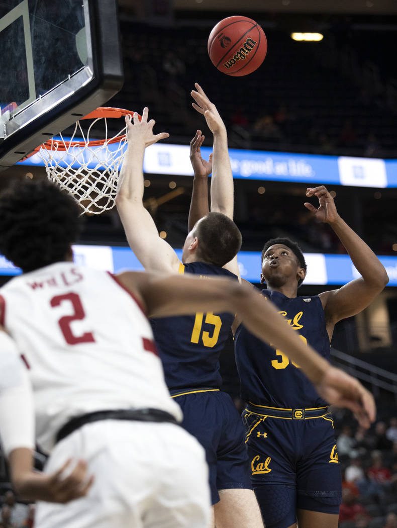 California's forward D.J. Thorpe (33) jumps to block a Stanford point during the game against S ...