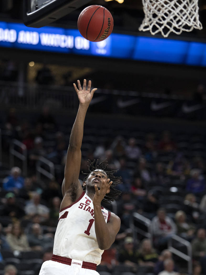 Stanford's guard Daejon Davis (1) attempts a point during the Pac-12 tournament at T-Mobile Are ...