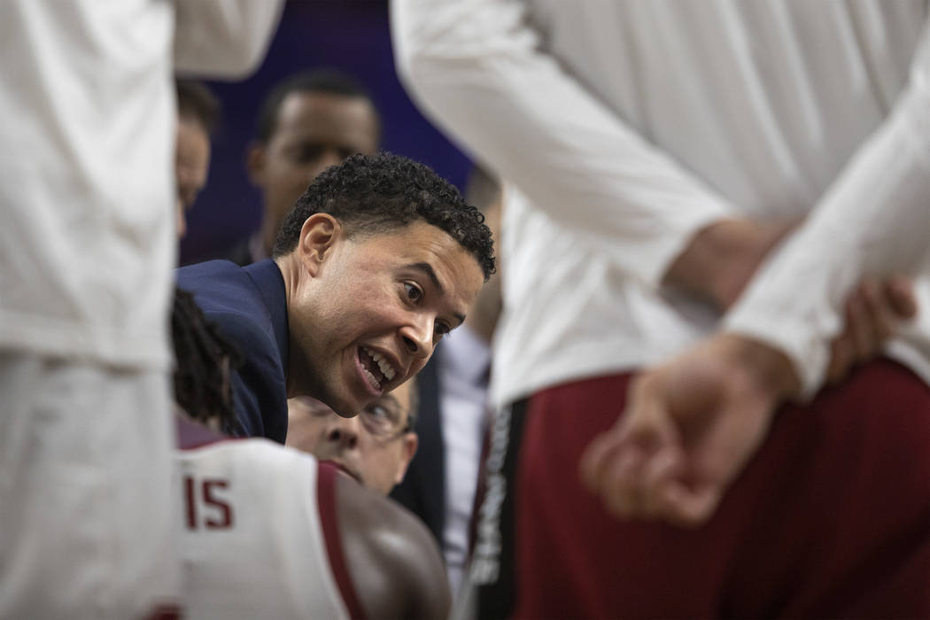 Stanford assistant coach Jesse Pruitt speaks to the team during a timeout at the game against U ...
