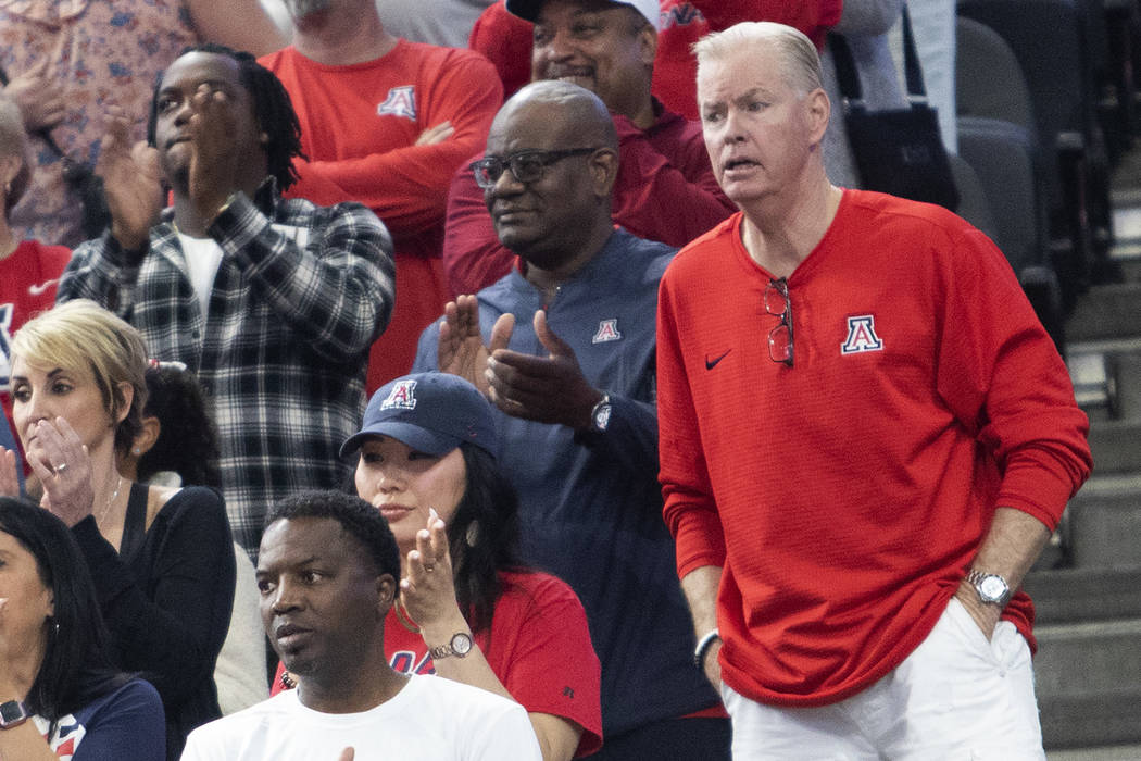 Pace Mannion, who went to Chaparral High School, watches his son, Nico Mannion, play basketball ...