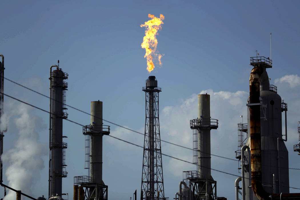 n a Thursday, Aug. 31, 2017, file photo, a flame burns at the Shell Deer Park oil refinery in D ...