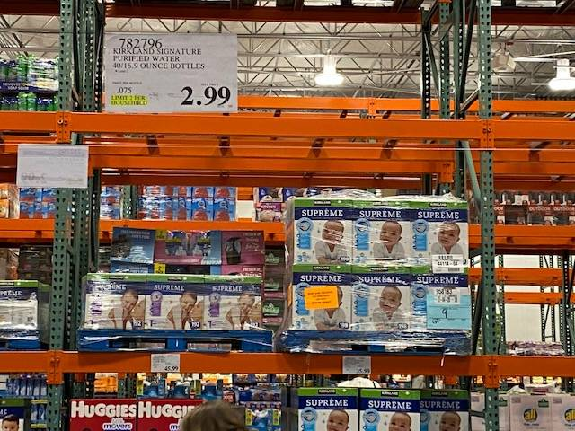Empty shelves thatt used to hold cases of water are seen at a Costco at 3412 Saint Rose Parkway ...