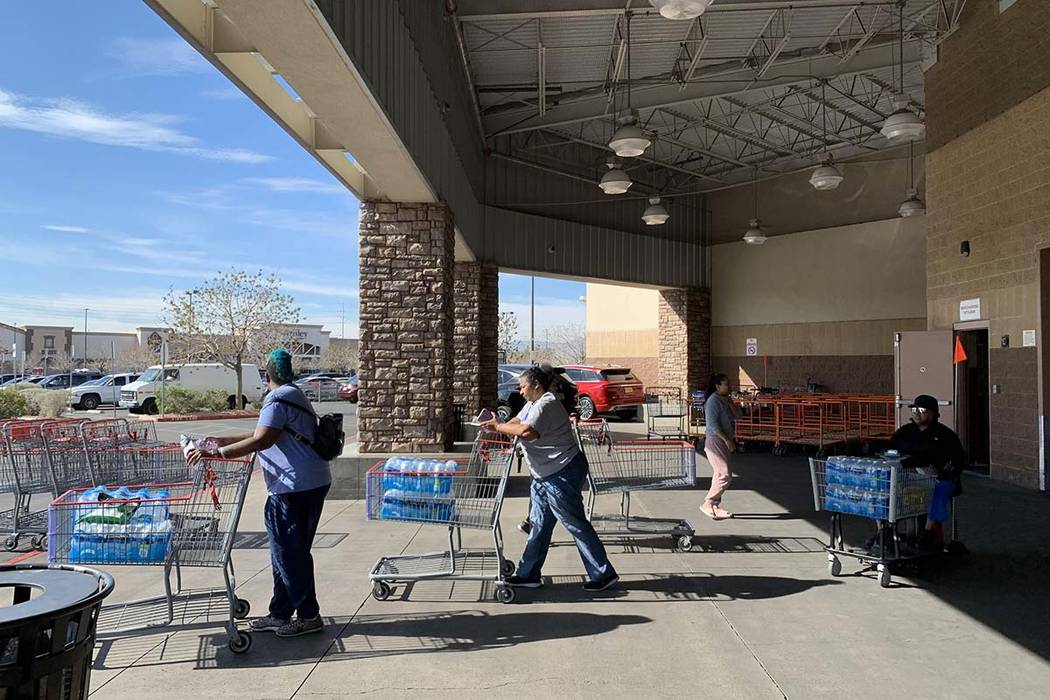 Customers at the Costco store at 6555 N. Decatur Blvd. in Las Vegas are stocking up on water an ...