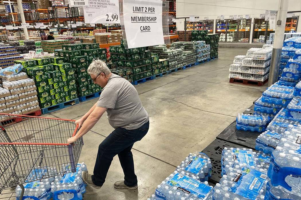 Shoppers stock up on bottled water at the Costco Business Center on Martin Luther King Boulevar ...