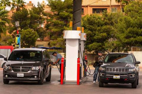 Patrons pump gas at a station on Flamingo Road at Koval Lane on Monday, April 15, 2019, in Las ...