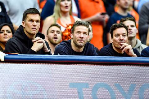 New England Patriots' Tom Brady, left, and Julian Edelman, center, along with comedian Jimmy Fa ...