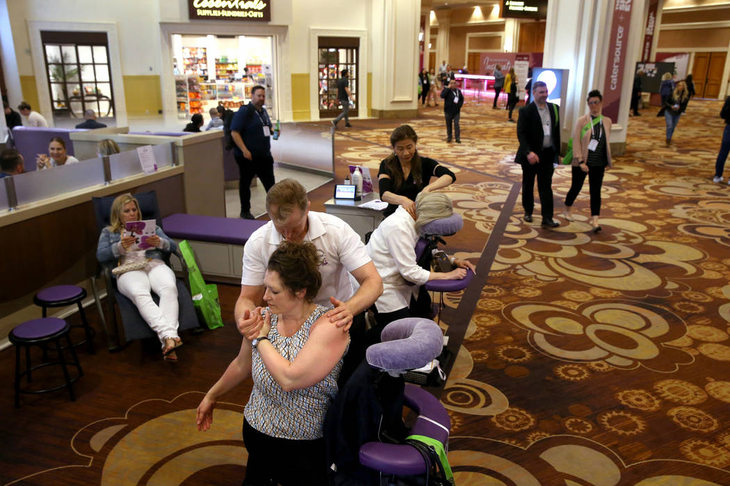Las Vegas massage therapist Troy Miller of massages Alisha Jepsen of Ames, Iowa while Ling Cool ...