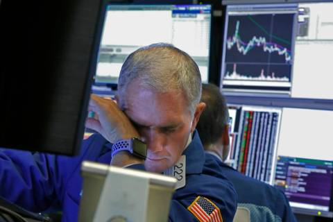 Specialist Timothy Nick works on the floor of the New York Stock Exchange, Monday, March 9, 202 ...