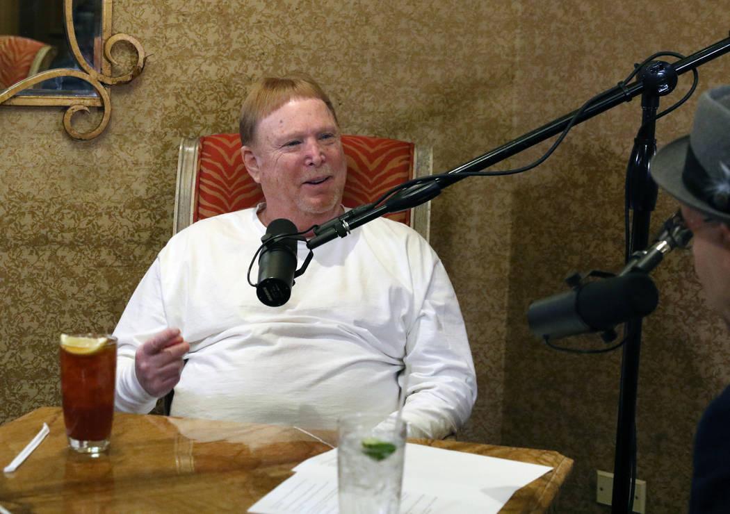 Las Vegas Raiders owner Mark Davis, left, speaks during his podcast with John Katsilometes on M ...