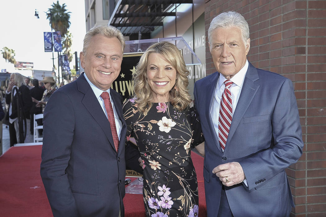 Pat Sajak, from left, Vanna White and Alex Trebek attend a ceremony honoring Harry Friedman wit ...