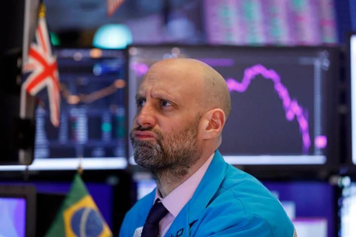 Specialist Meric Greenbaum works at his post on the floor of the New York Stock Exchange, Monda ...
