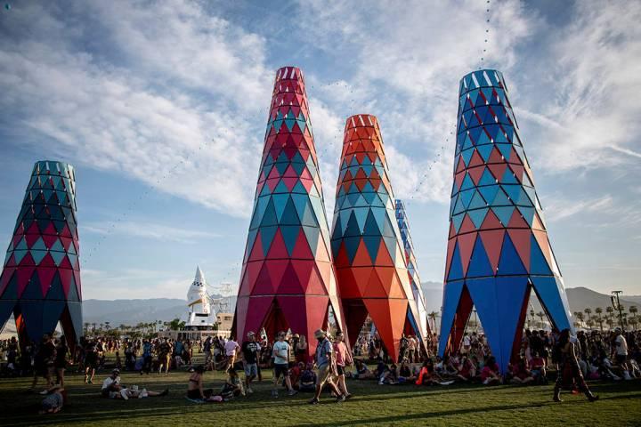 Festivalgoers attend the Coachella Music & Arts Festival at the Empire Polo Club on Sunday, Apr ...
