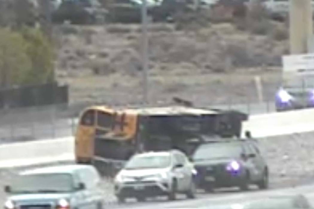 A Clark County School District bus sits on its side on Tuesday, March 10, 2020. (RTC cameras)