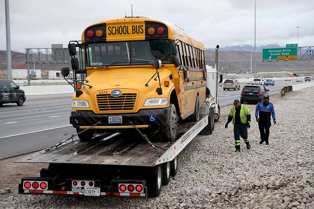 Clark County School District police, Nevada Highway Patrol and tow truck operators prepare to r ...