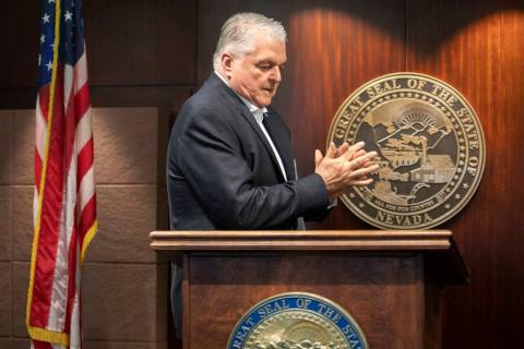 Gov. Steve Sisolak uses hand sanitizer before taking the podium to update the public about COVI ...