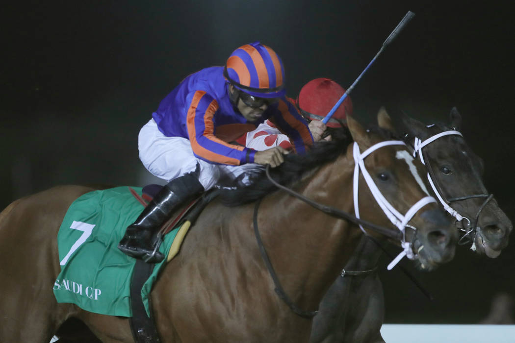Jockey Luis Saez rides his horse, Maximum Security as he reaches the finish line of the $20 mil ...